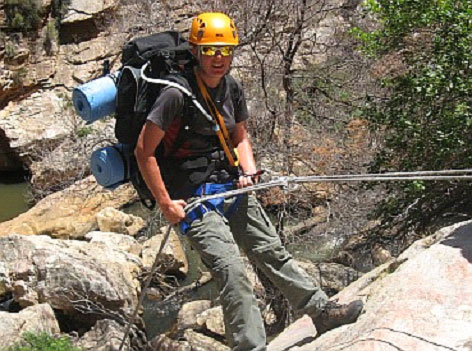 A guest abseiling into the Nuy River Gorge