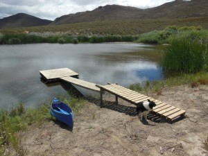 Wooden jetty and raft at the little farm dam
